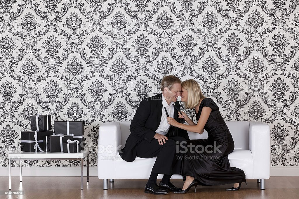 Couple romancing on the couch royalty-free stock photo