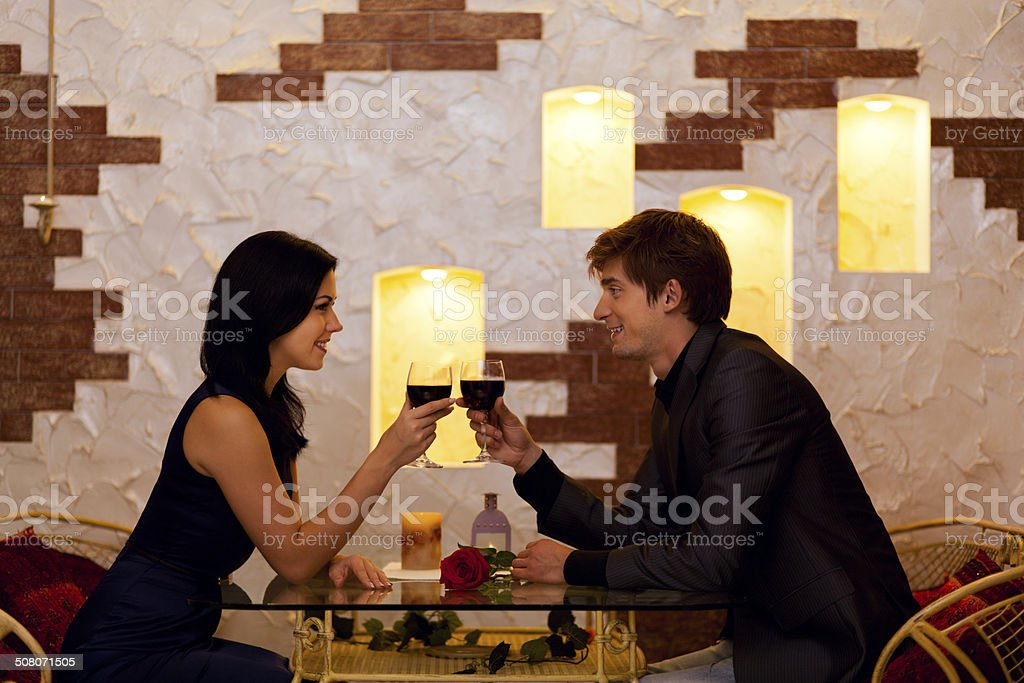 Couple romantic date drink glass of red wine at restaurant stock photo