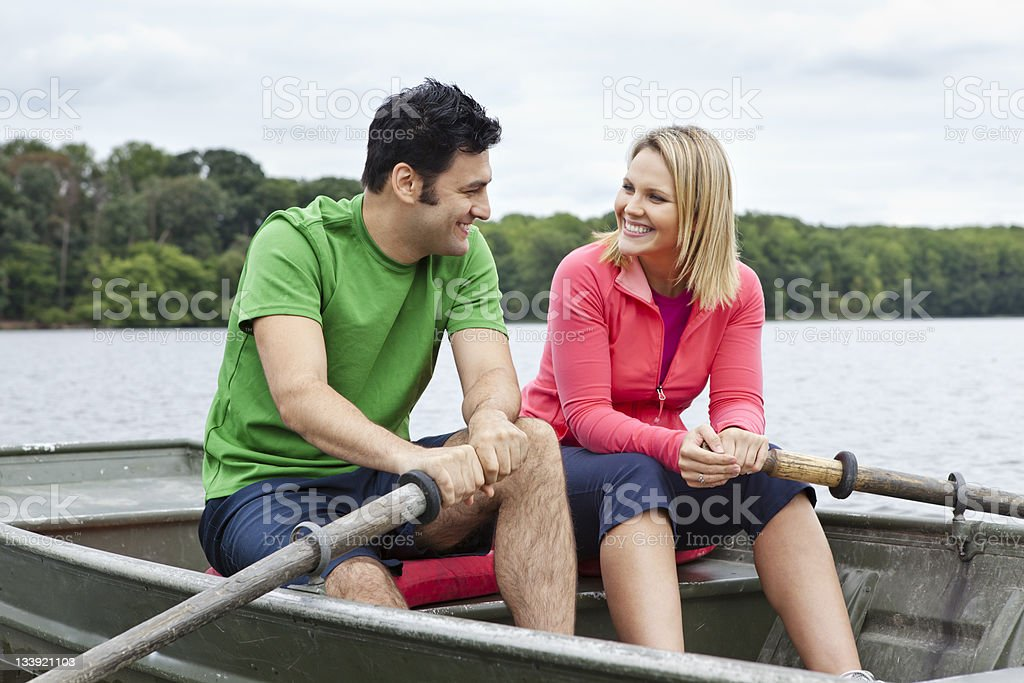 Couple Rowing Boat royalty-free stock photo