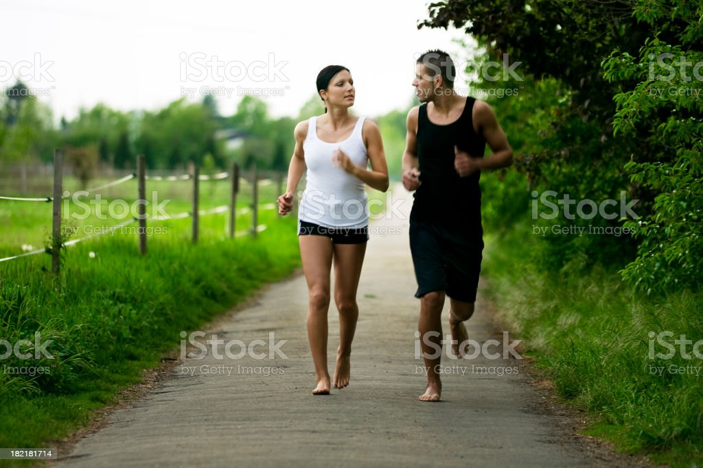 Couple Running Barefoot stock photo