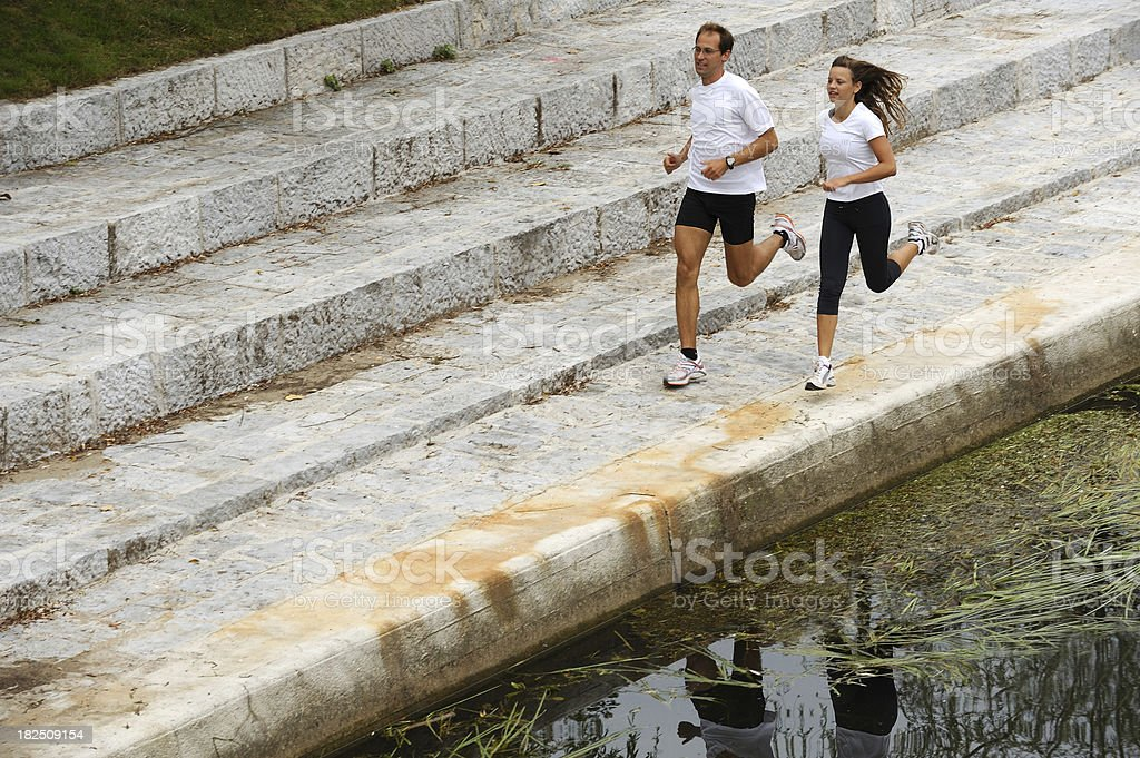 Couple running by the river royalty-free stock photo