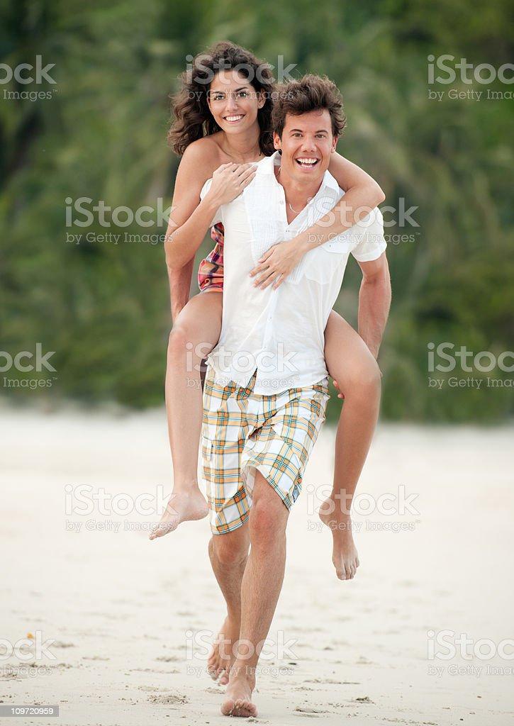 Couple running down Paradise Beach (XXXL) royalty-free stock photo