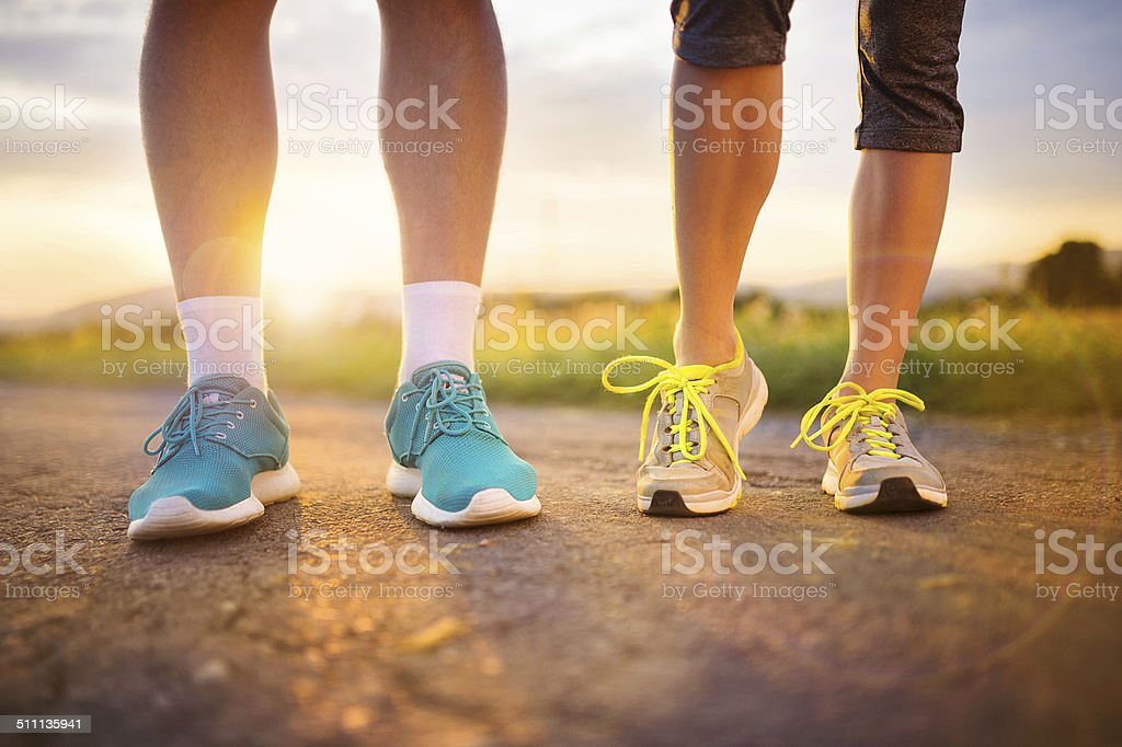 Couple running feet closeup stock photo