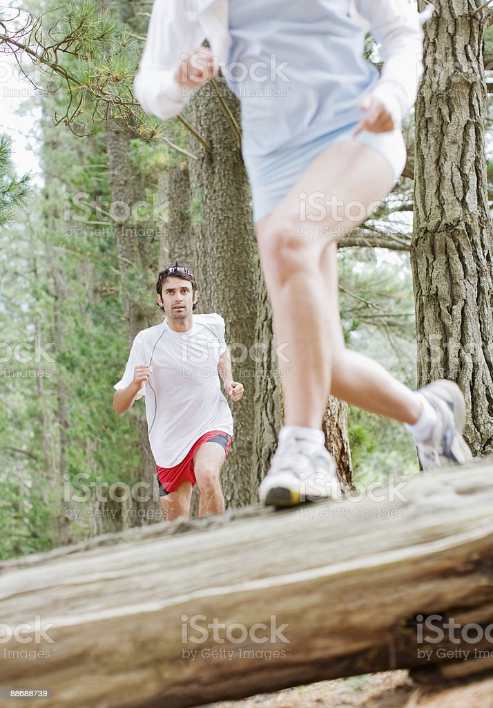 Couple running in forest royalty-free stock photo