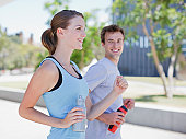 Couple running in urban environment