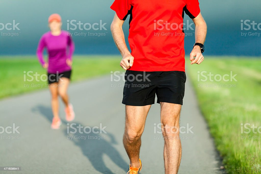 Couple running on country road royalty-free stock photo