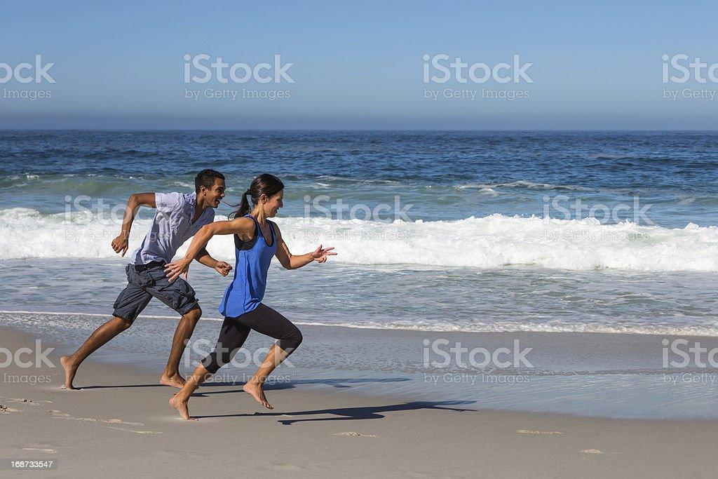Couple Running on the Beach stock photo