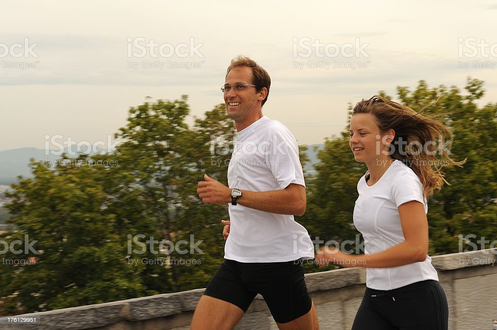 Couple running royalty-free stock photo