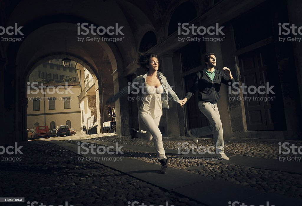 couple running scare stock photo