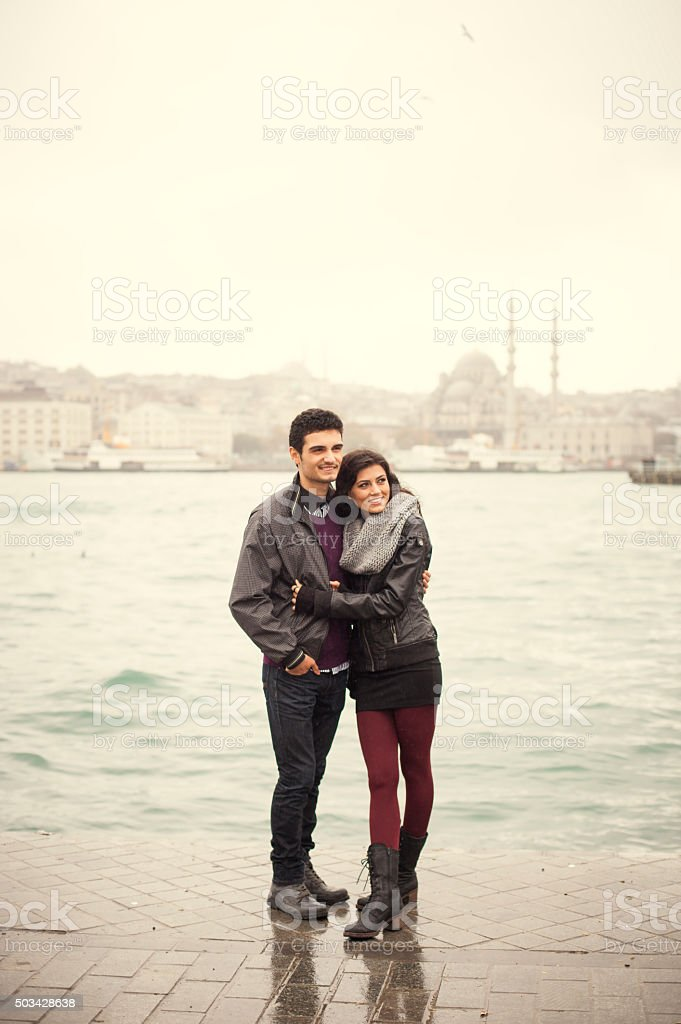 Couple Safe Together in Rainy Weather stock photo