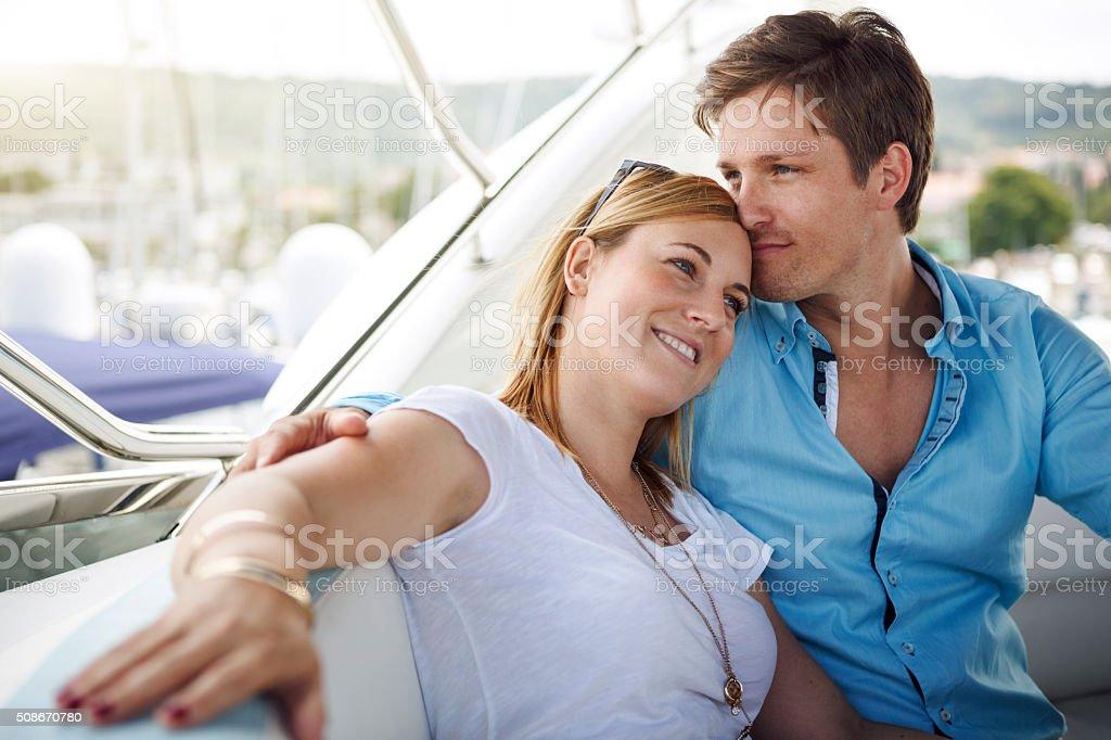 Couple sailing on boat stock photo