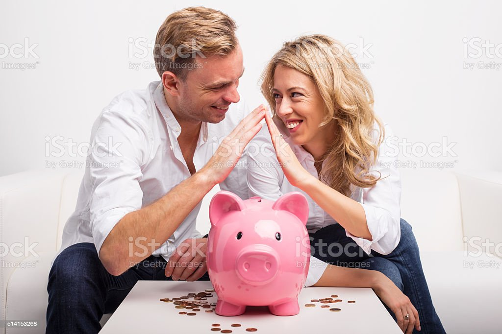 Couple saving money to buy house stock photo