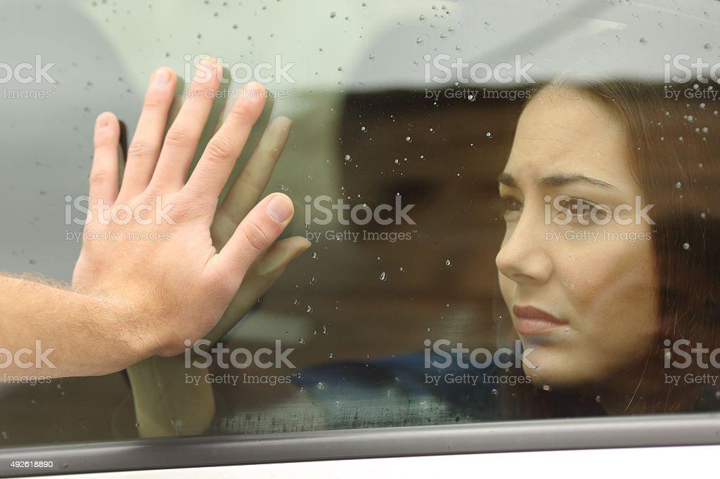Couple saying goodbye before car travel stock photo