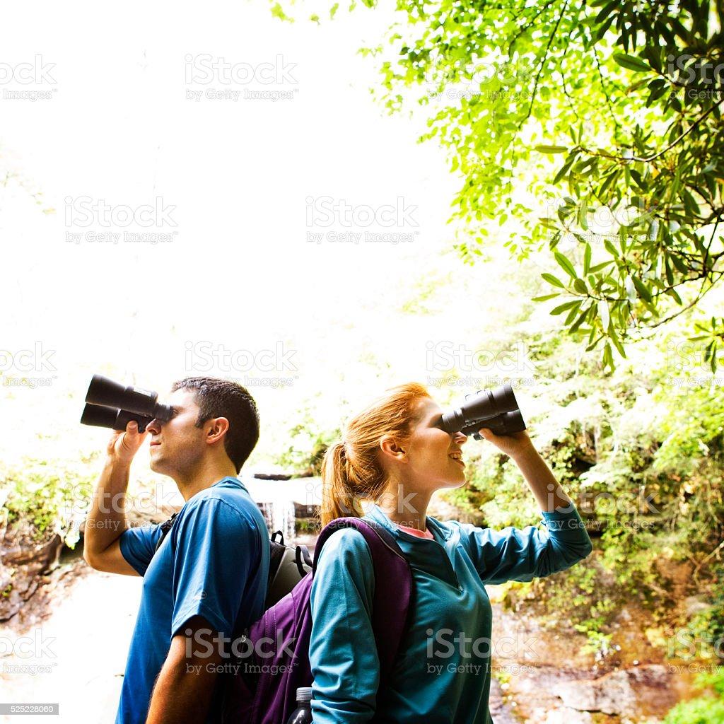 Couple Searching with Binocluars stock photo