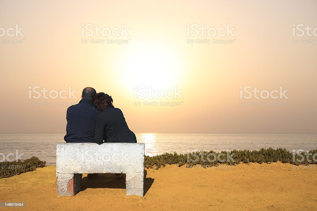 couple seated royalty-free stock photo