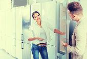 couple selecting  refrigerator