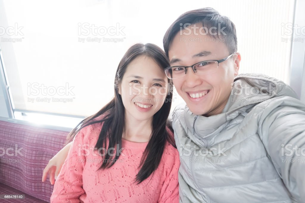 couple selfie in bus stock photo