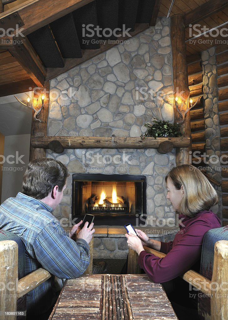 Couple sending text messages in romantic setting royalty-free stock photo