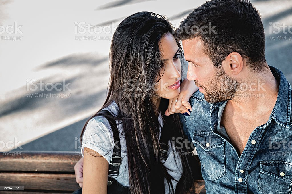 Couple seriously looking at each other stock photo