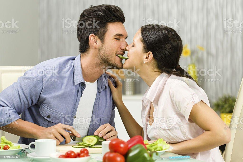 Couple sharing cucumber royalty-free stock photo