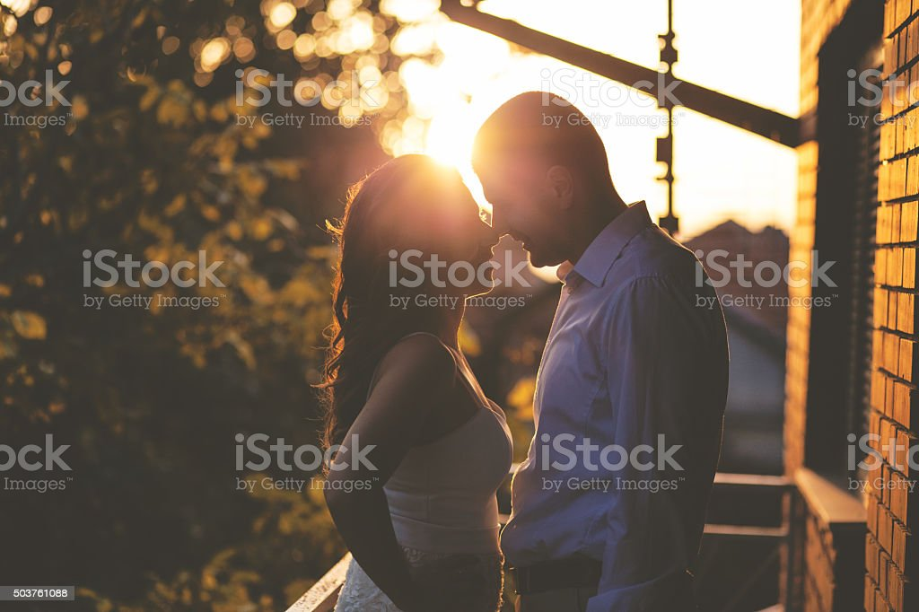 Couple sharing romantic sunset stock photo