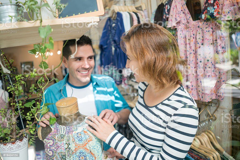 Couple shopping at a clothing store stock photo