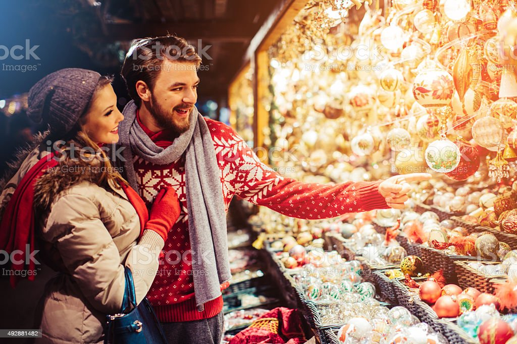 Couple shopping at christmas fair. stock photo