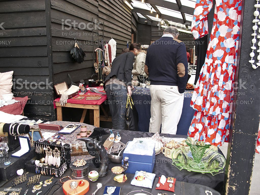 Couple shopping at open air antique street stall royalty-free stock photo