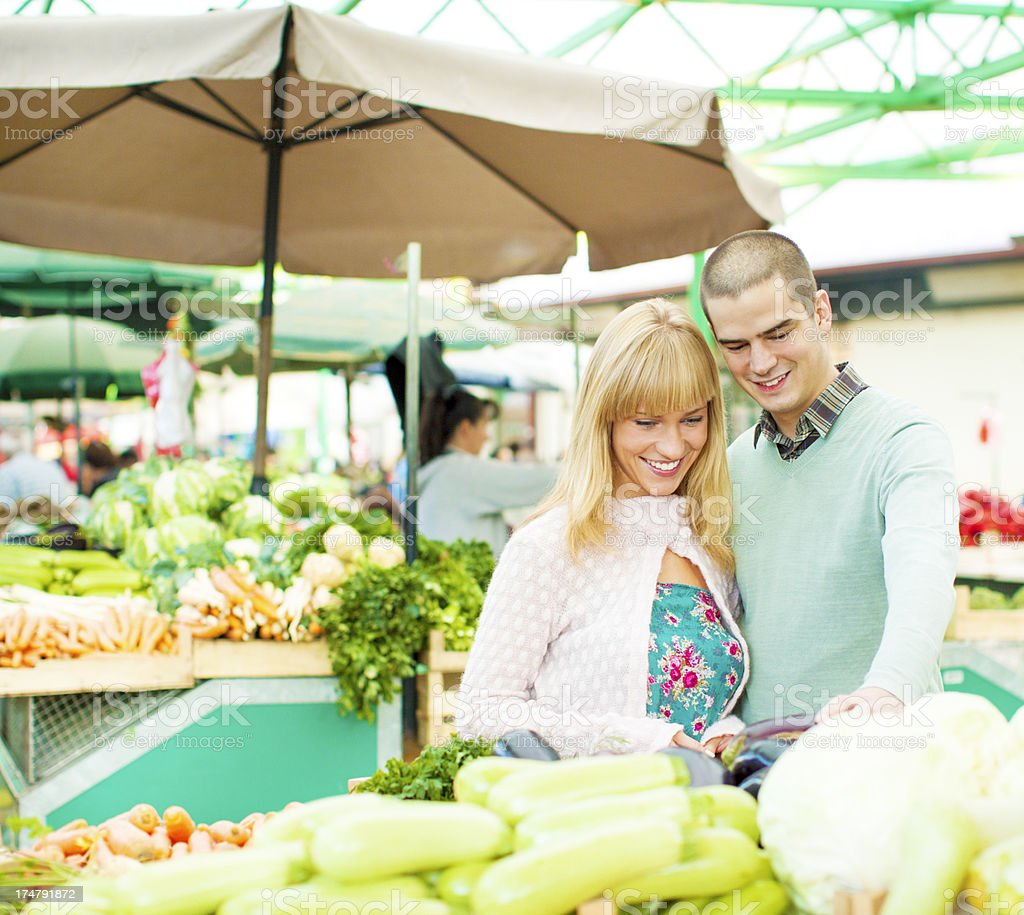 Couple shopping at open market. royalty-free stock photo