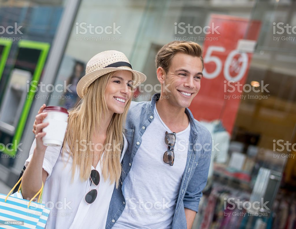 Couple shopping at the mall stock photo