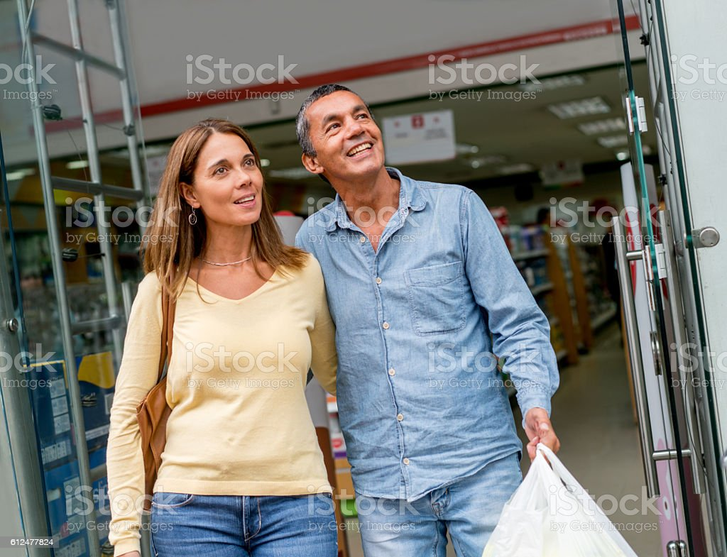 Couple shopping at the pharmacy stock photo