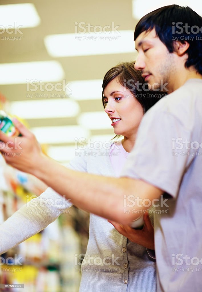 Couple shopping at the supermarket royalty-free stock photo