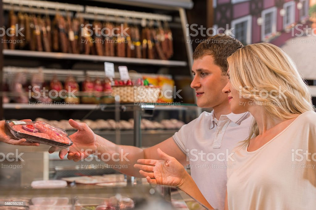 Couple shopping at the supermarket stock photo