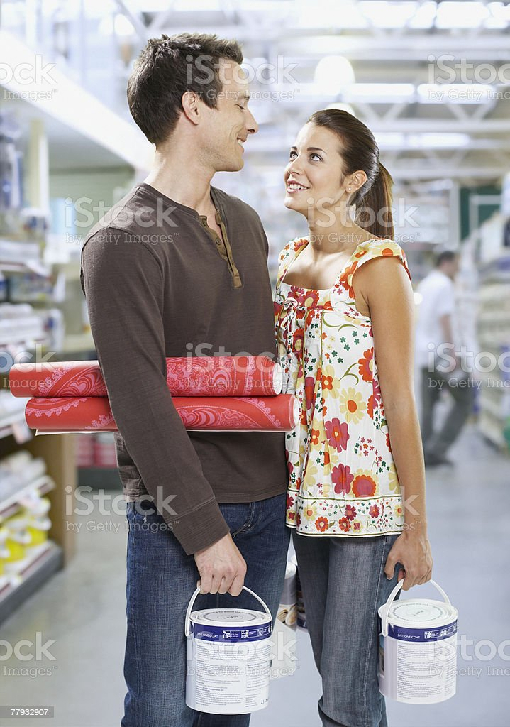 Couple shopping for paint and wallpaper royalty-free stock photo