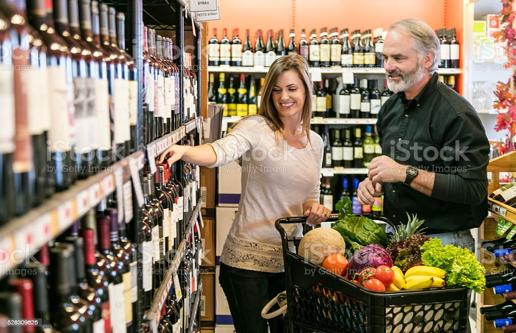 Couple shopping for Wine stock photo