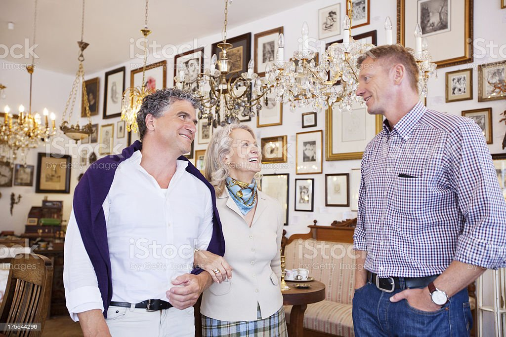 Couple shopping in an antique store stock photo