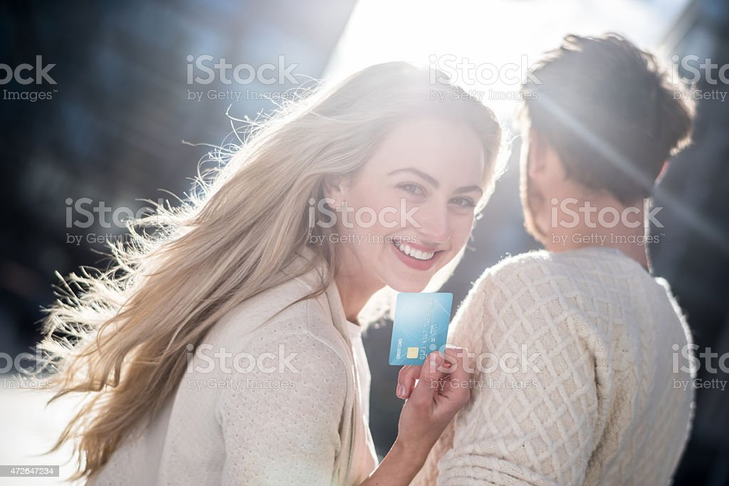 Couple shopping with a credit card stock photo