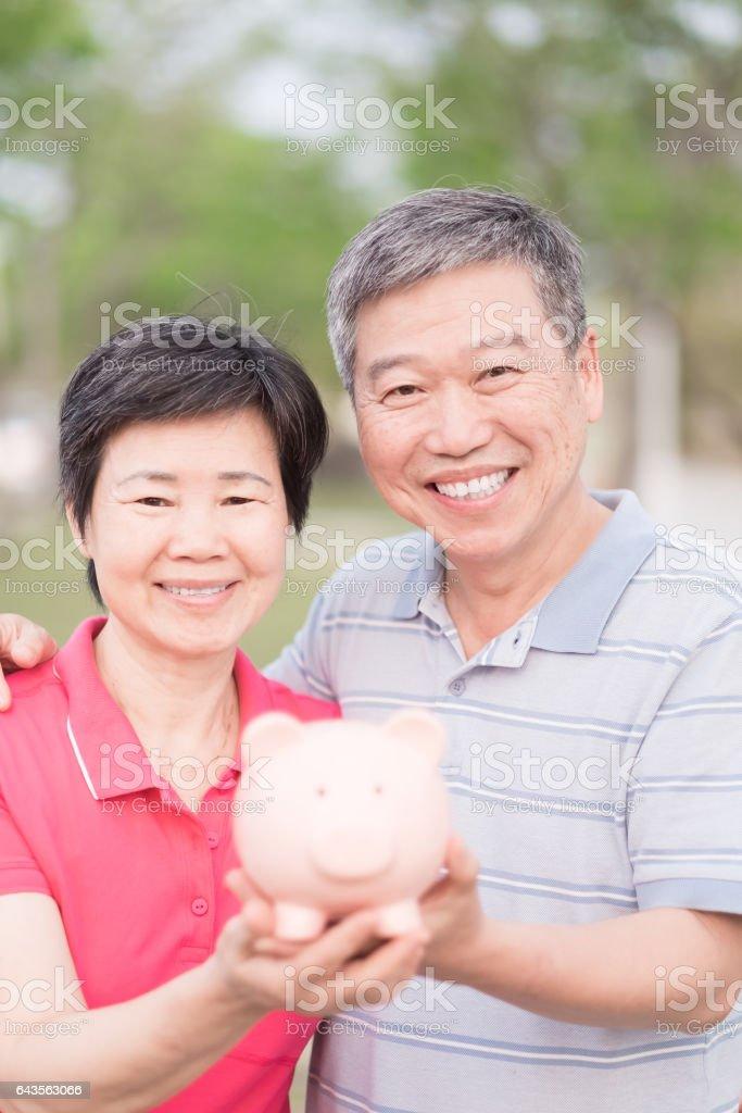 couple show pig piggy bank stock photo