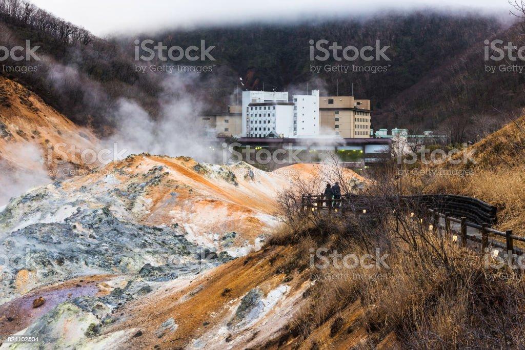 Couple sightseeing Jigokudani hell valley at late evening in Noboribetsu, Hokkaido stock photo