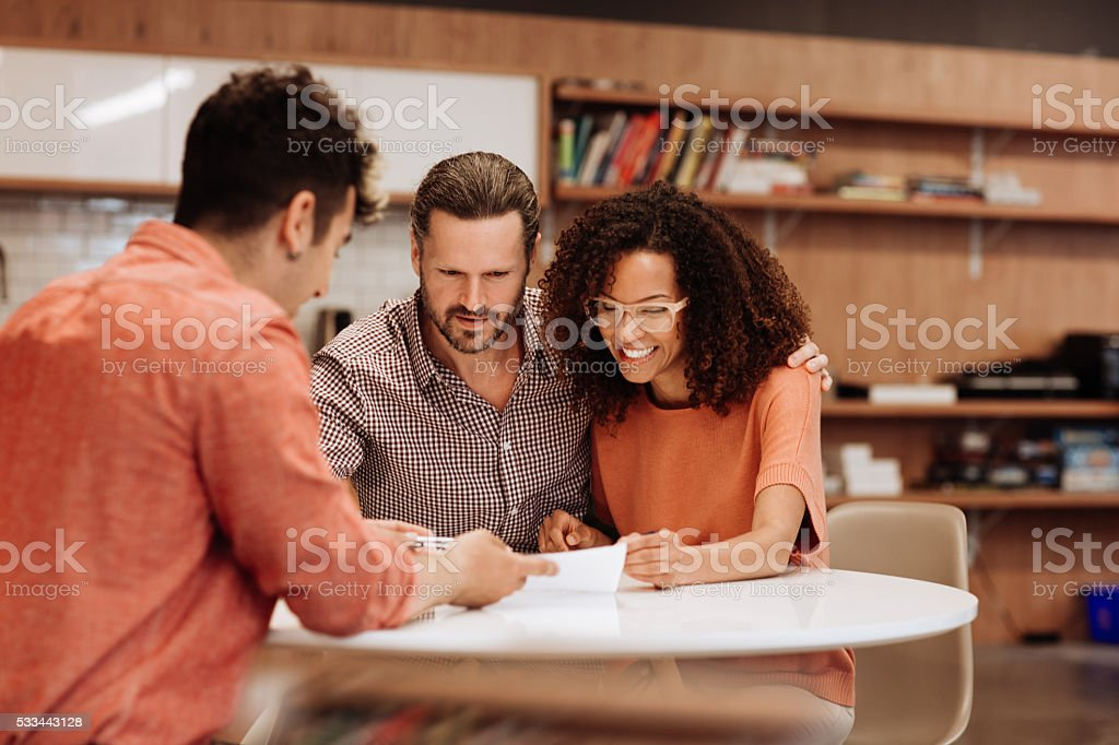 Couple signing a contract stock photo