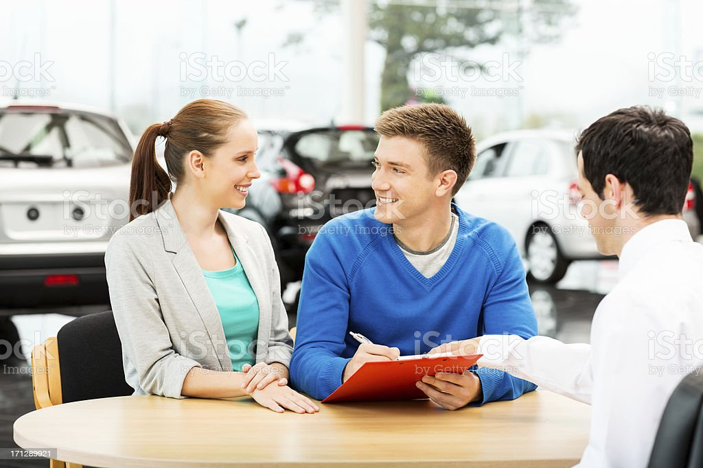 Couple Signing Agreement royalty-free stock photo