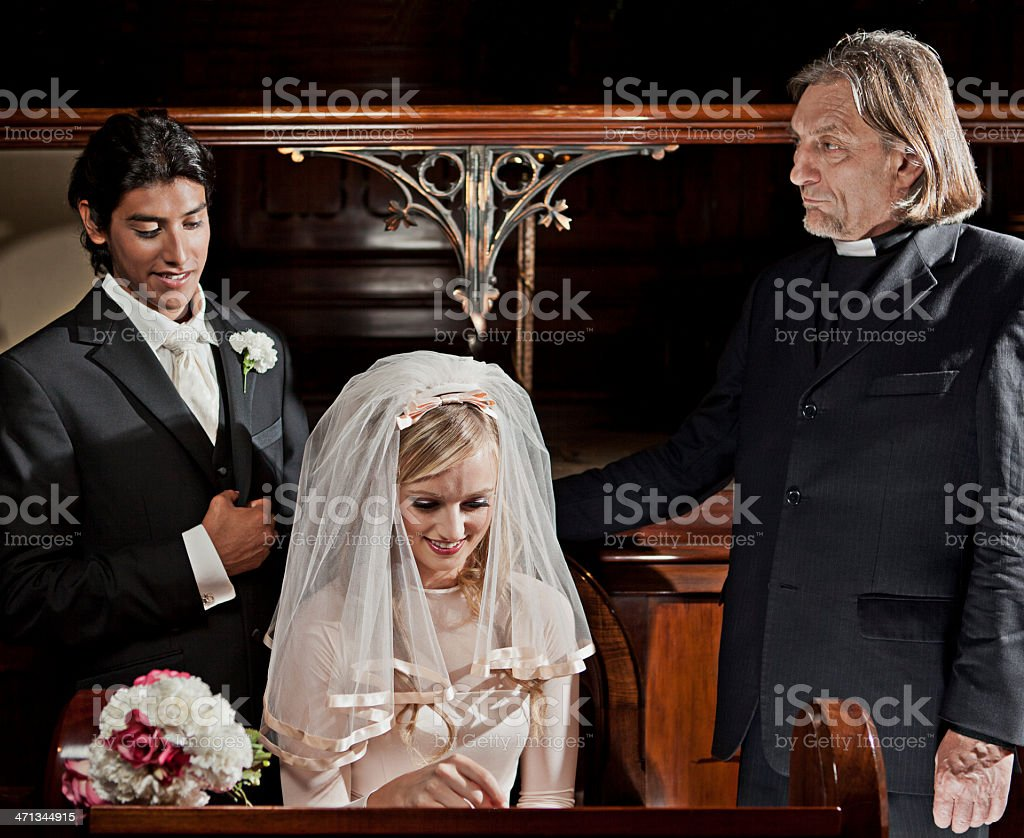 Couple signing marriage register stock photo