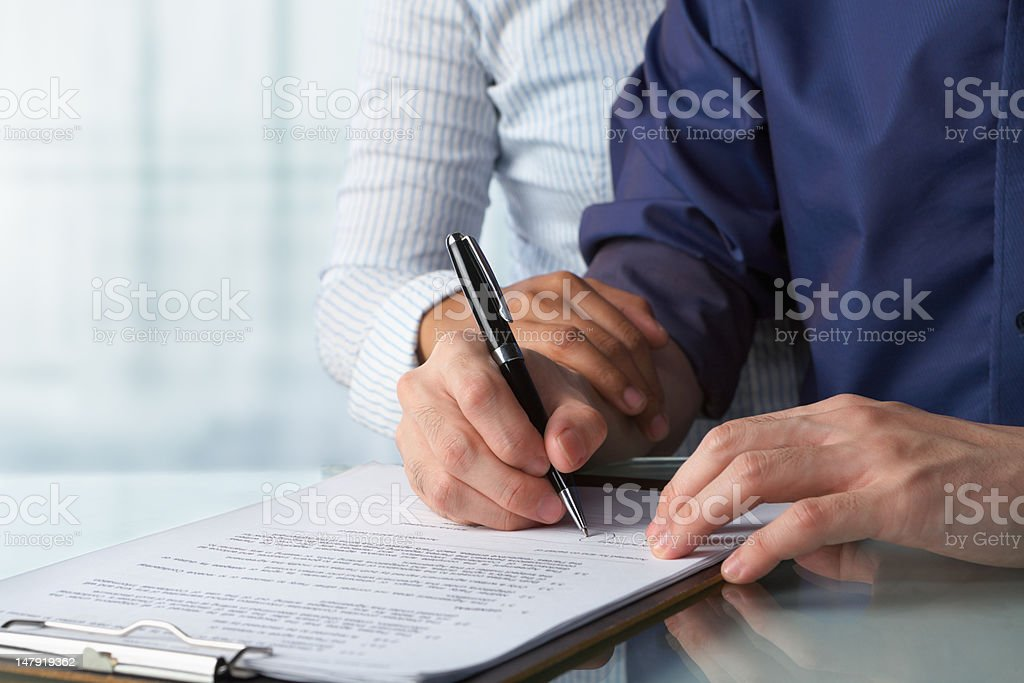 Couple signing paper royalty-free stock photo