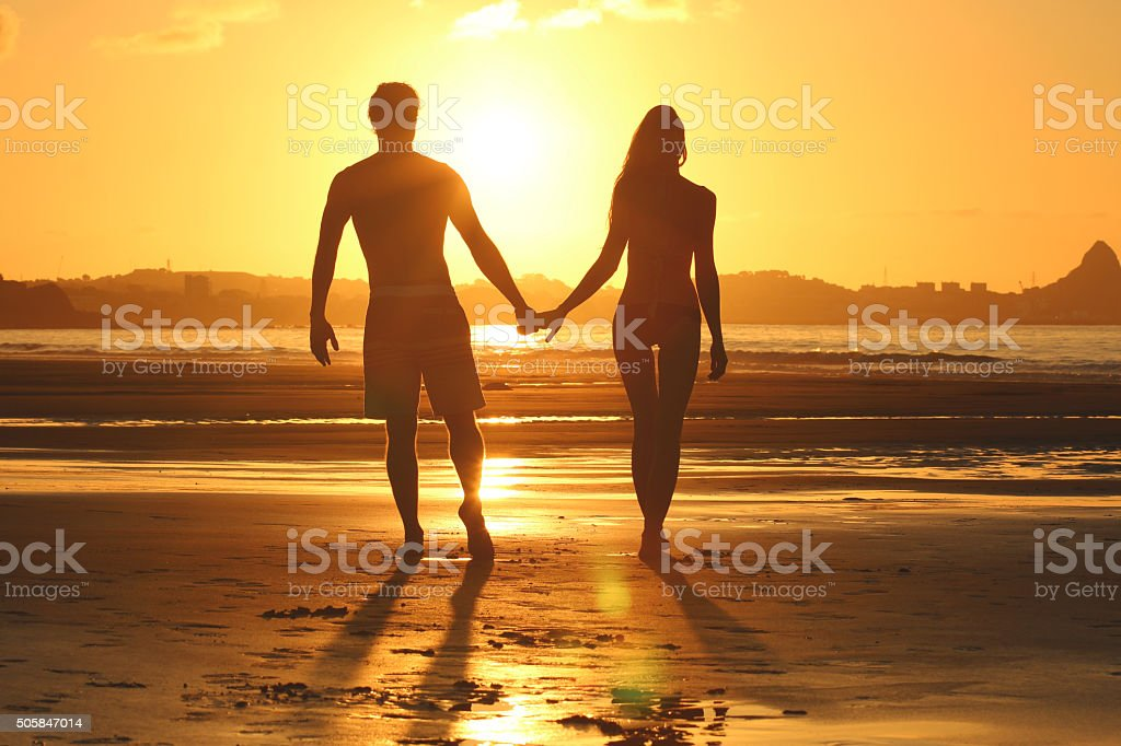 Couple silhouette at the beach stock photo