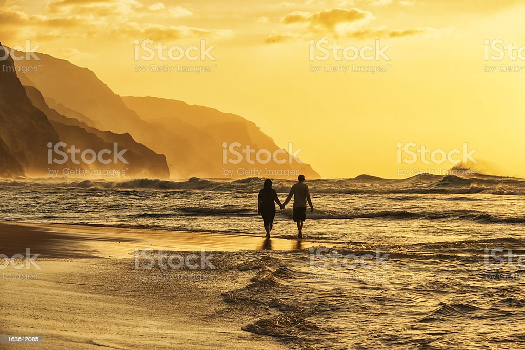 Couple Silhouette on Beach stock photo
