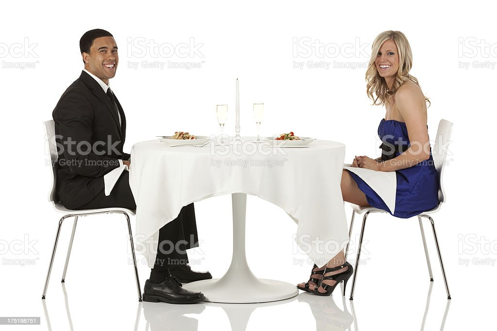 Couple sitting at a restaurant royalty-free stock photo