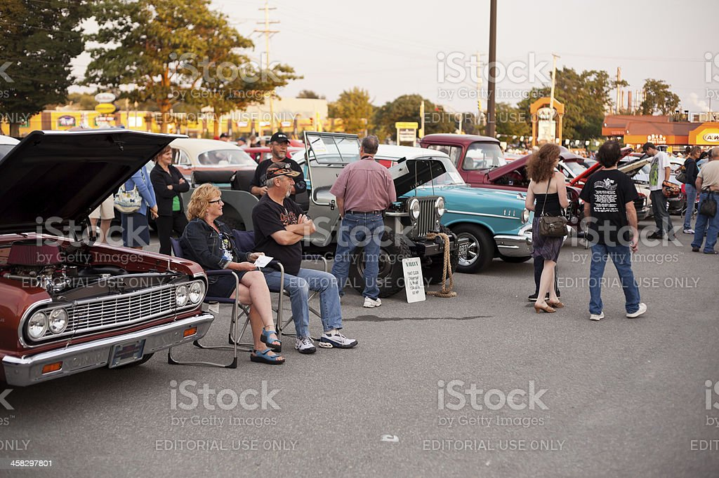 Couple Sitting by Their Classic Chevrolet royalty-free stock photo