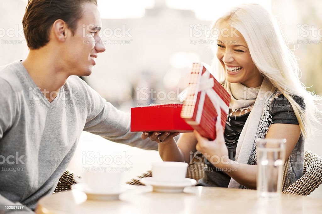Couple sitting in a cafe on Valentine's Day. stock photo