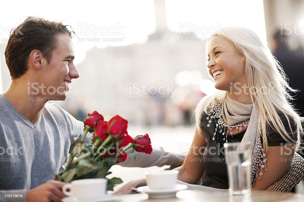 Couple sitting in a cafe on Valentine's Day royalty-free stock photo