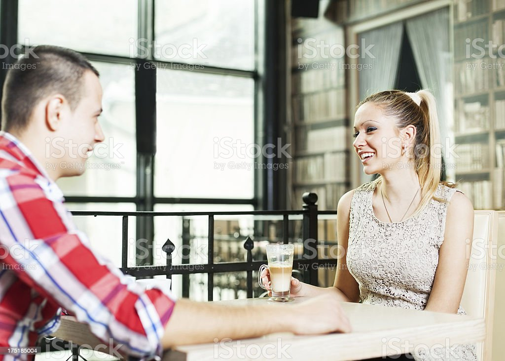 Couple sitting in a cafe royalty-free stock photo